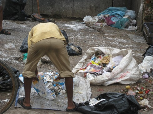 Ragpicker sorting waste